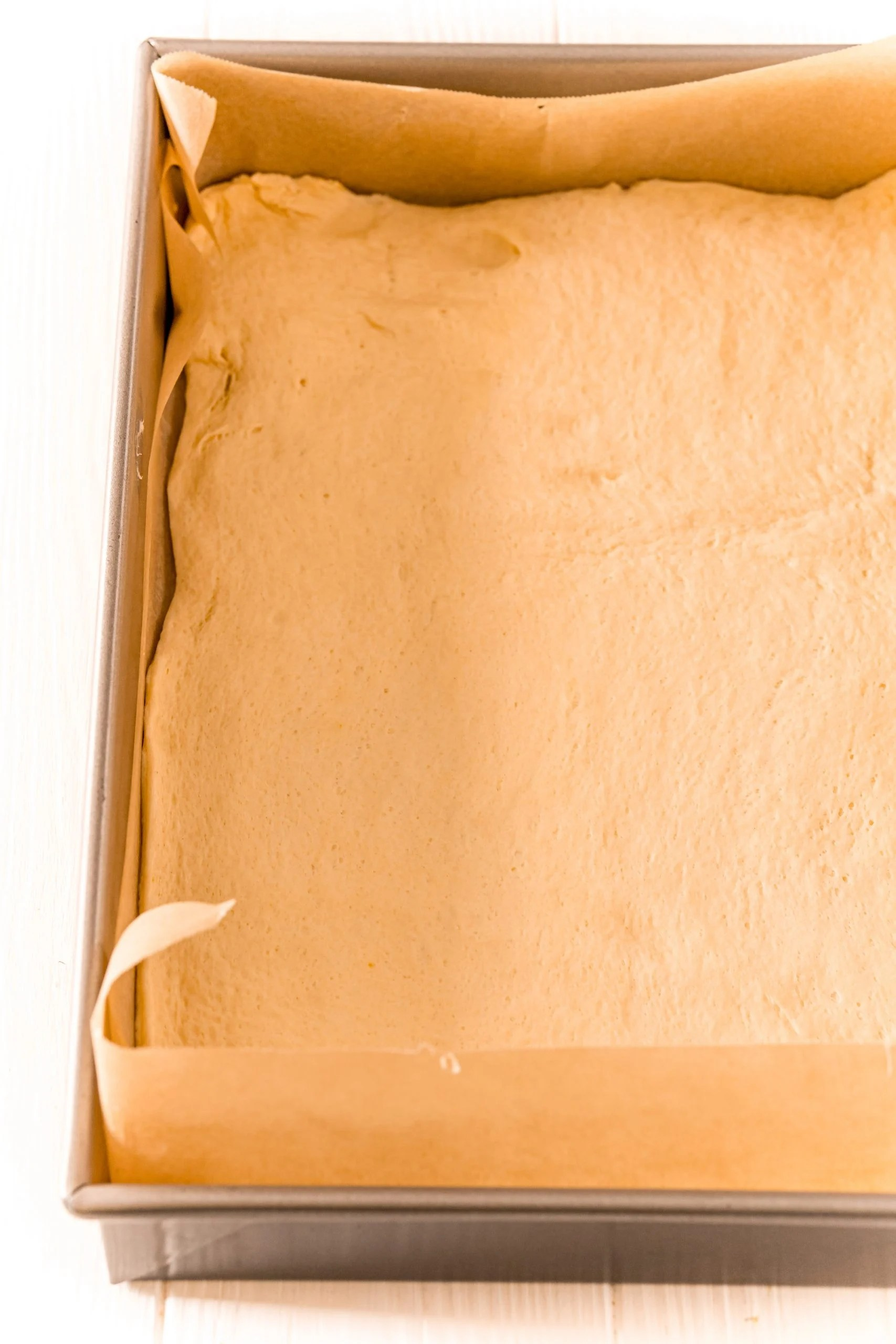 picture of dough in a baking dish with parchment paper