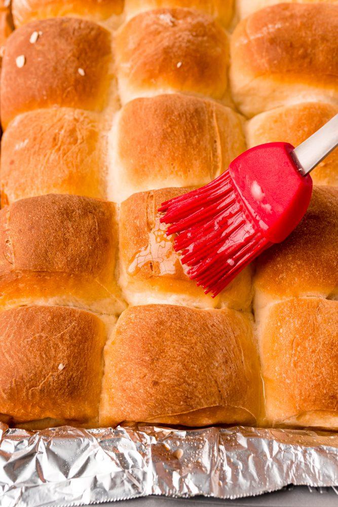 picture of pastry brush brushing butter on dinner rolls