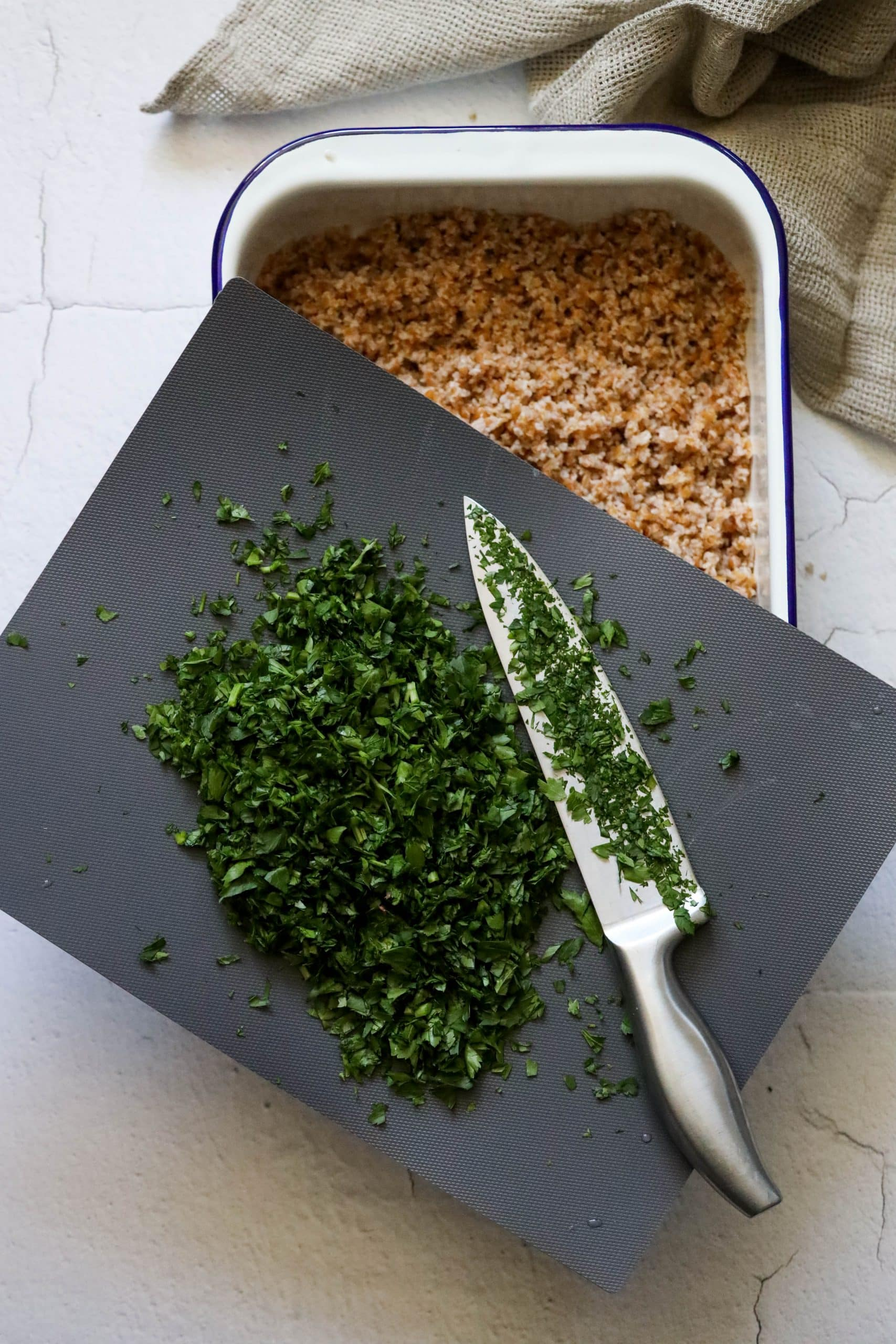 picture of finely minced parsley on a cutting board