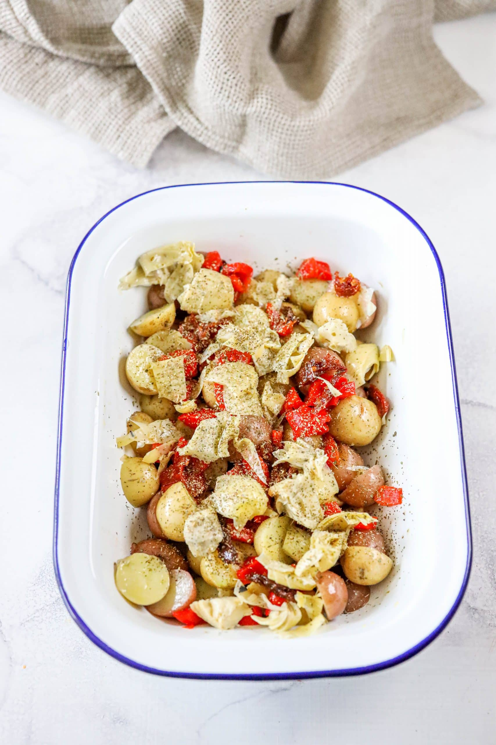 picture of potatoes and red pepper strips and artichokes in a platter