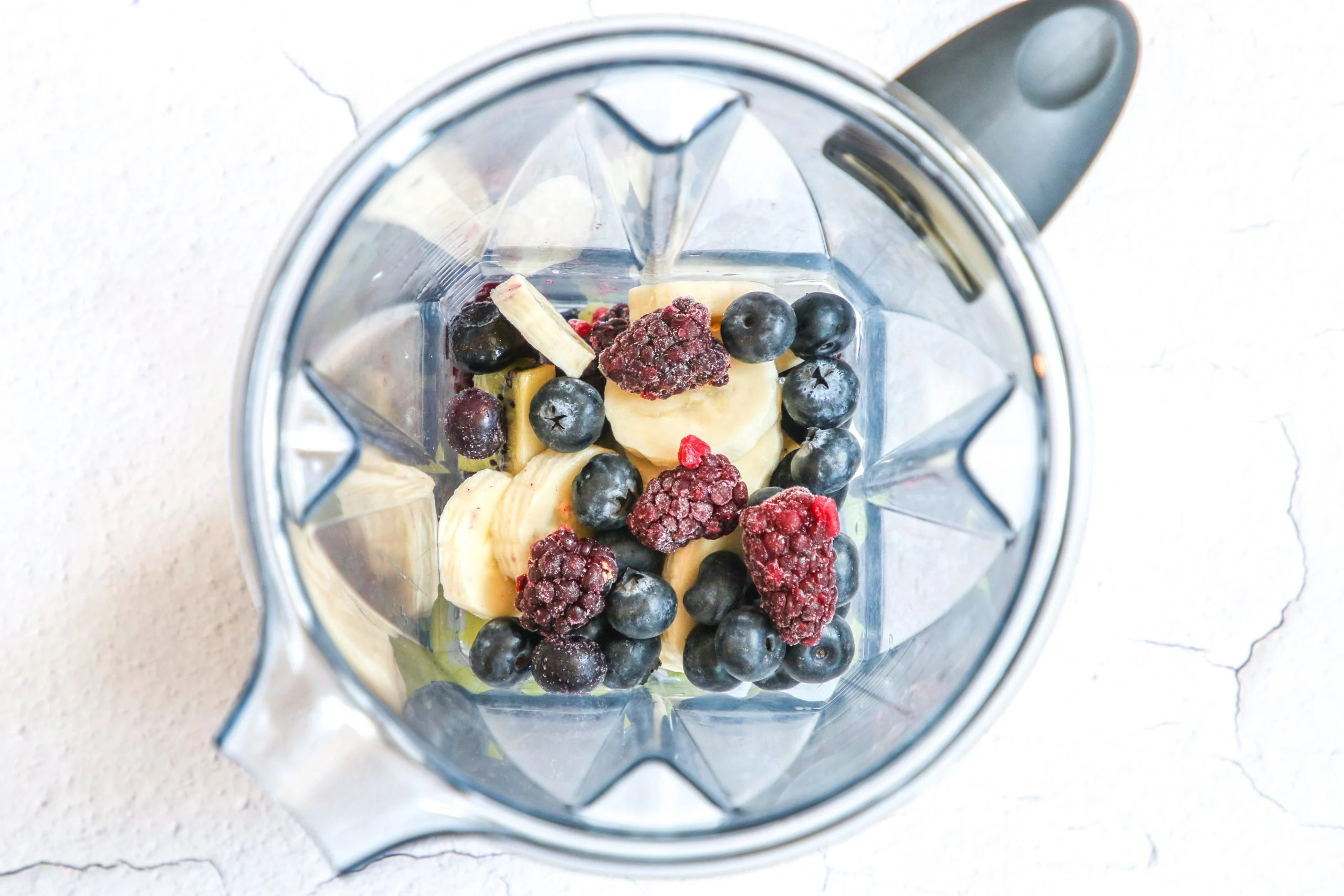 picture of banana and berries in a blender