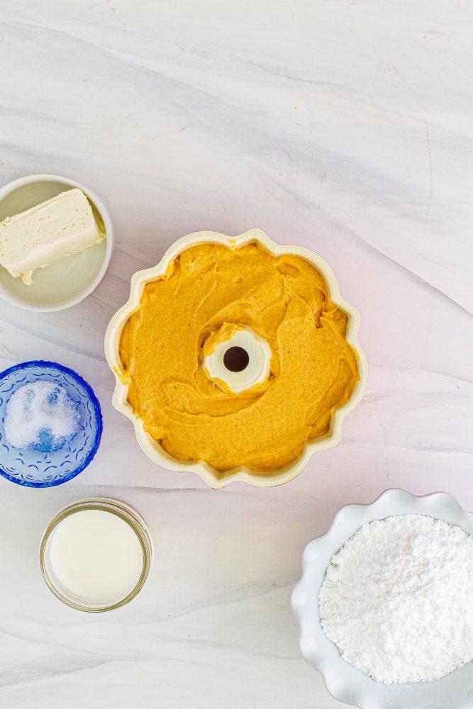 picture of pumpkin bundt cake batter in a bundt pan