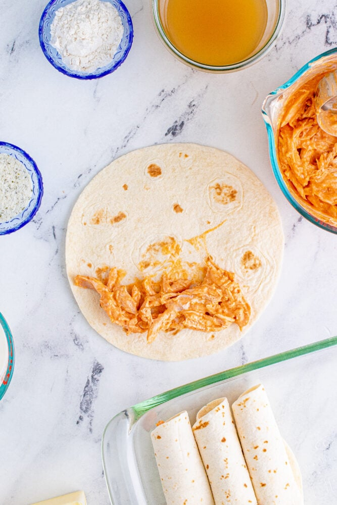 picture of shredded chicken with tortilla on a table