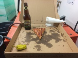 Dinner for the Rousanne pressing crew is pizza and beer.