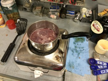Infusing the Locati Sangiovese with garlic; bringing the wine just to a boil.