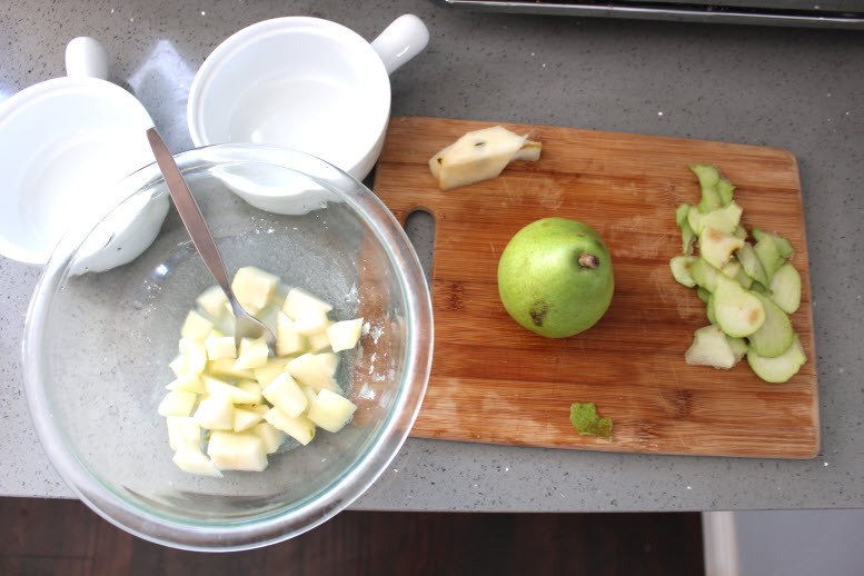 Cutting pears to make pear crisp