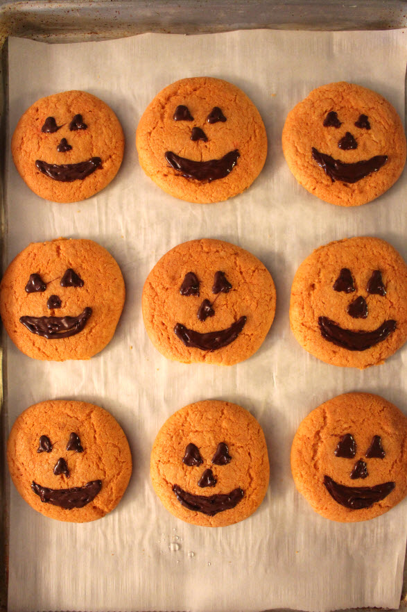 pumpkin cookies with frosting or chocolate faces