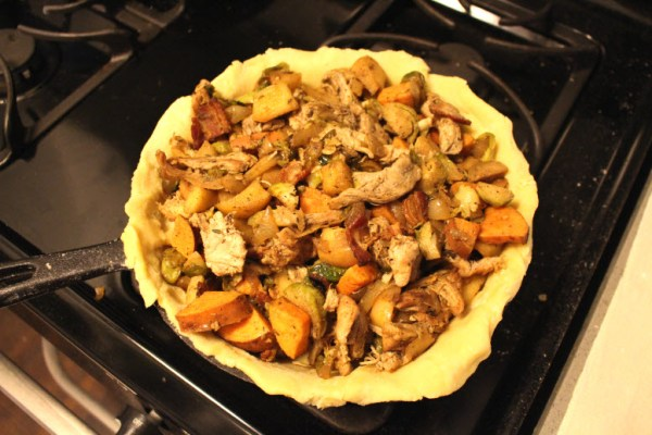 Making a savory chicken apple veggie pie