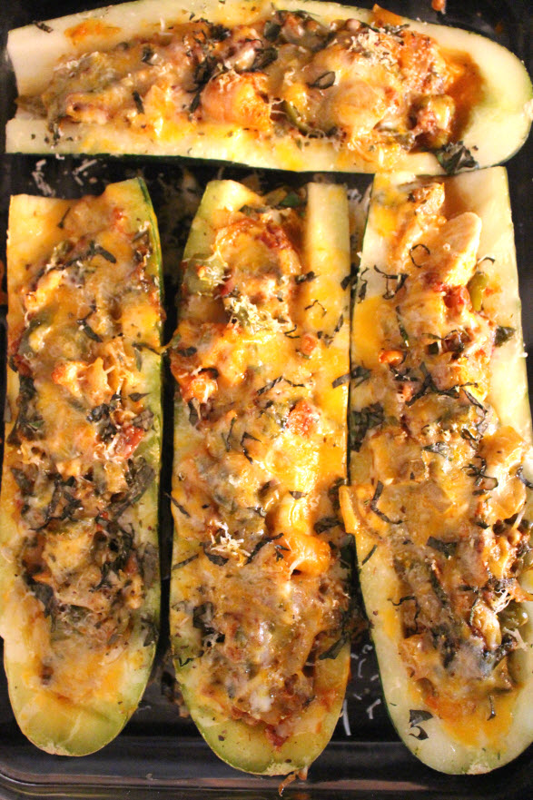 zucchini boats with chicken and cheese and tomato sauce