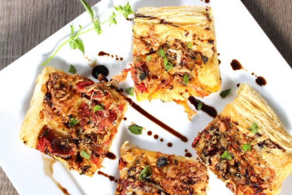 Roasted Tomato Puff Pastry Appetizer drizzled with balsamic vinegar