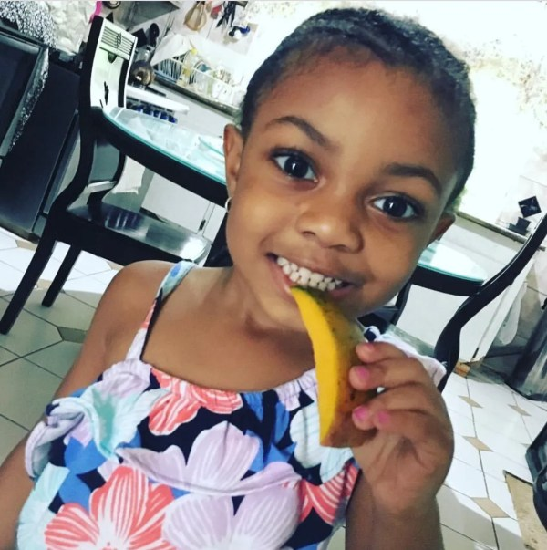 Anya enjoying Mango in Jamaica