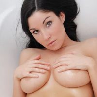 Sweet Krissy: Busty babe Sweet Krissy shows off her big wet tits and round ass in the shower