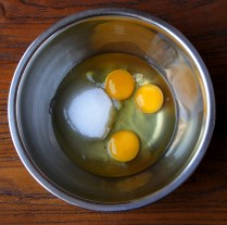 Place sugar+eggs in the bowl