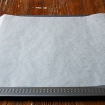 Cover baking sheet w/paper
