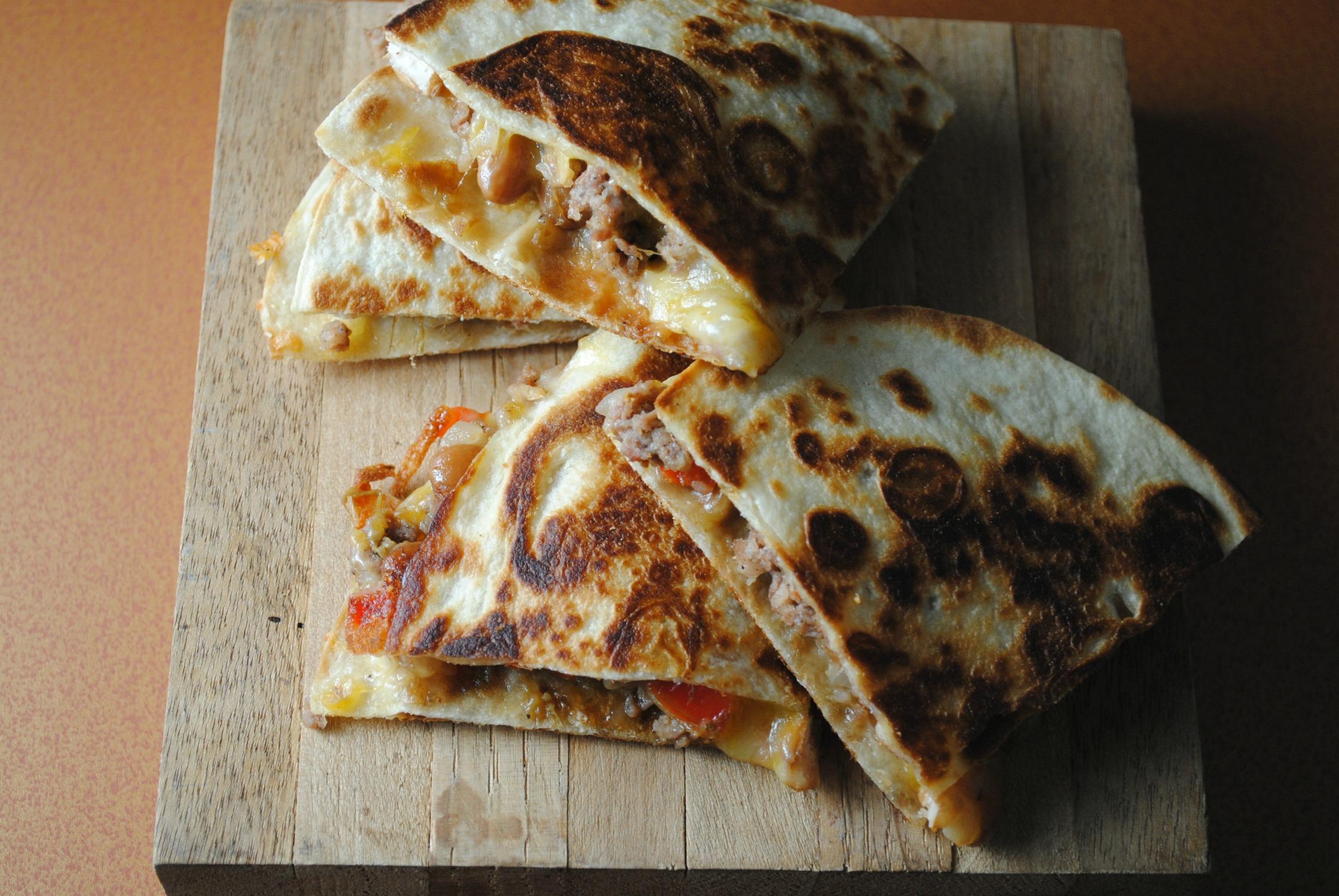 http://sweetlifebake.com/2014/09/10/pinto-bean-sausage-quesadillas/