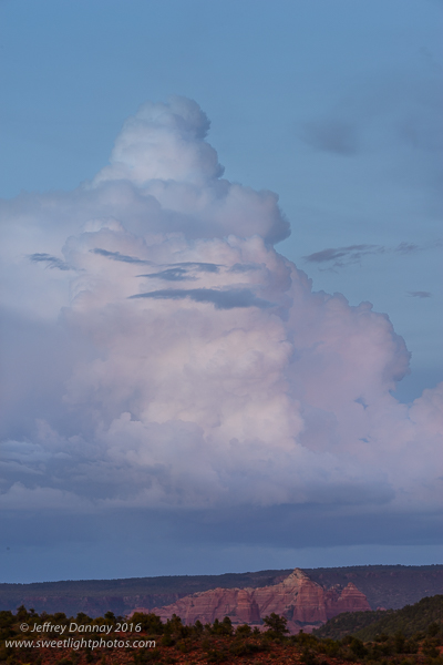 I turned to my left and saw these clouds over the pink rocks. Amazing how blue they sky was during the sunset.
