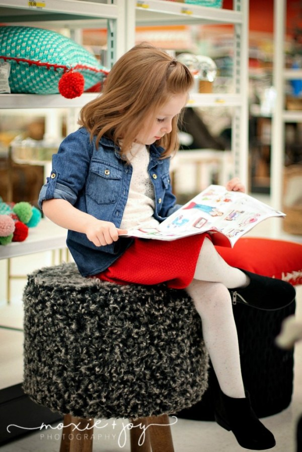 girl reading Target flyer
