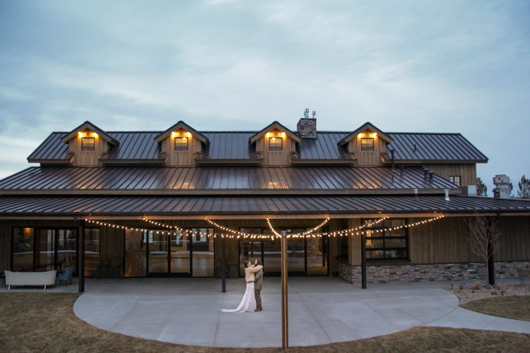 I think the back of this venue is so sweet. The hanging lights and the beautiful sunset backdrop is perfect for first dances and cocktail hour.