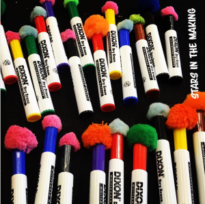 pom poms as erasers for dry erase markers