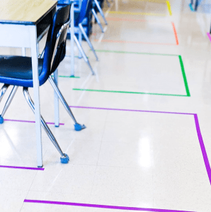 colorful tape spacing for social distancing in the classroom