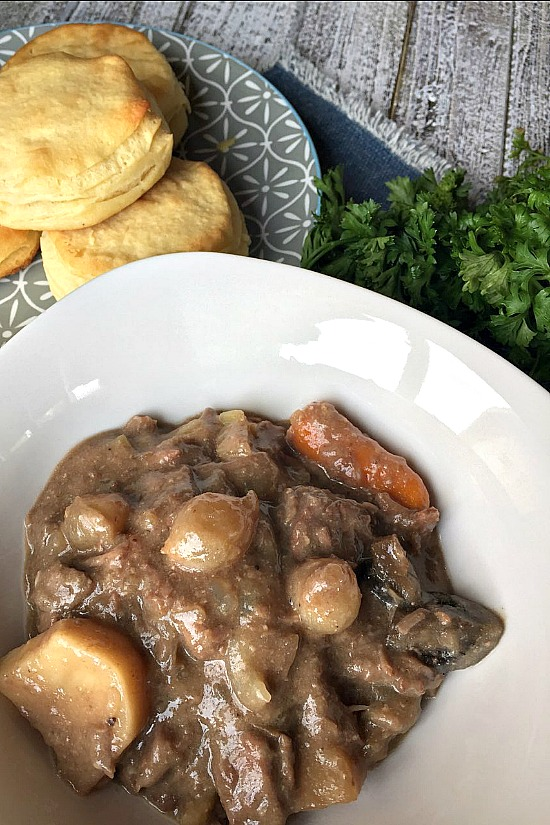 Slow Cooker Beef Stew with hot dinner rolls.