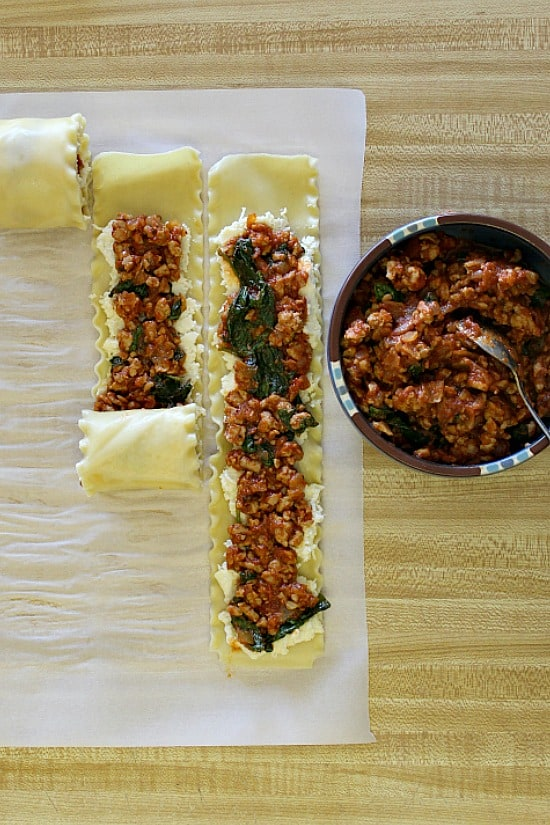 Stages of lasagna roll ups mid roll.