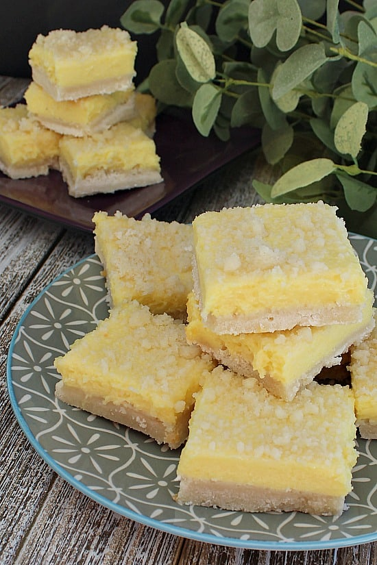 Sugar Cookie Lemonade Crumble bars stacked.