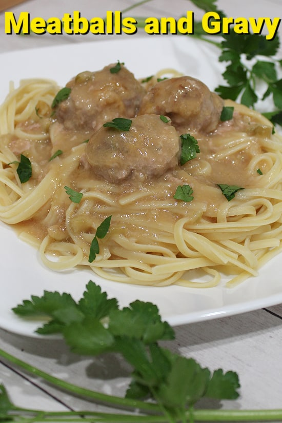 Linguini smothered in creamy gravy with meatballs.