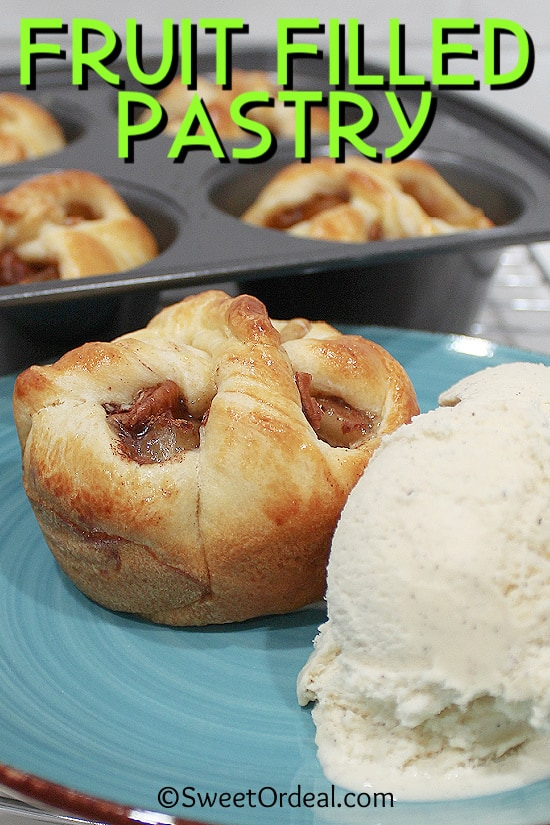 Basket shaped pastry filled with apple filling next to scoop of ice cream.