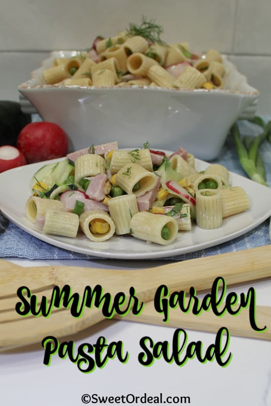 Rigatoni and ham with fresh vegetables and light dressing.