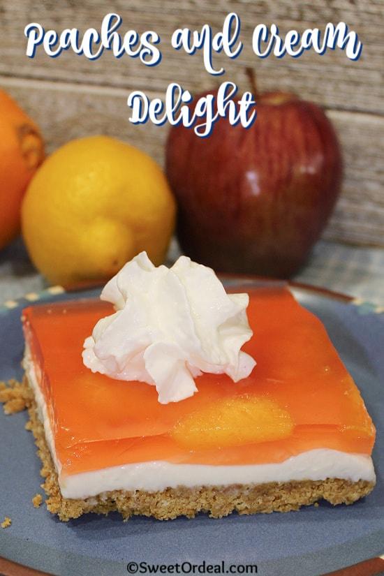 A peach layered dessert with cream cheese on a graham cracker crust.