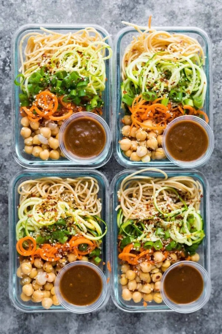 These cold sesame noodle meal prep bowls are the perfect vegan prep ahead lunch: spiralized vegetables tossed with chickpeas and whole wheat spaghetti in a spicy almond butter sauce.#sweetpeasandsaffron #mealprep #vegan #lunch #noodles