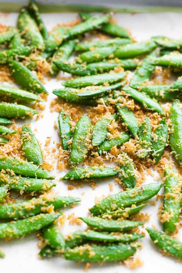 roasted sugar snap peas on sheet pan with breadcrumbs and parmesan cheese