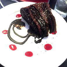 """The Ridiculous Belgian Triple Chocolate Cake"" at Belgian Bistro Waterzooi in Garden City. The name says it all."