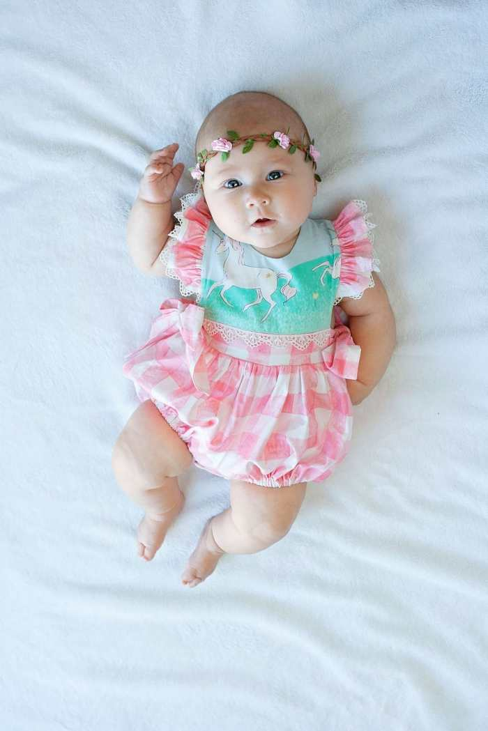 Front view of M4M Hampton Baby Romper PDF Sewing Pattern in Sarah Jane Magic Fabric from Michael Miller Fabrics