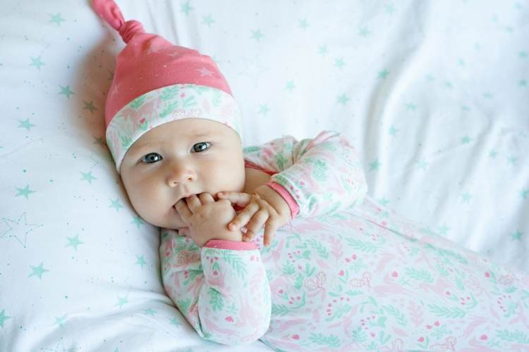 Baby Vivienne wearing a Zaaberry knit hat PDF Sewing Pattern in Sarah Jane Magic Knit Fabric from Michael Miller Fabrics