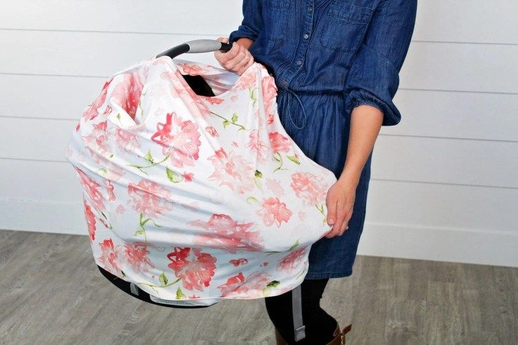 Learn how to sew this easy 7 in 1 carseat canopy and get the free pattern at Sweetredpoppy.com