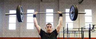 A man lifting weights, strength training