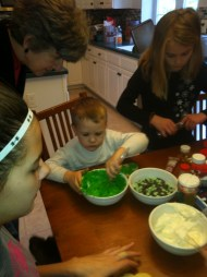 Will has moved on to the green frosting, while my mom oversees his work
