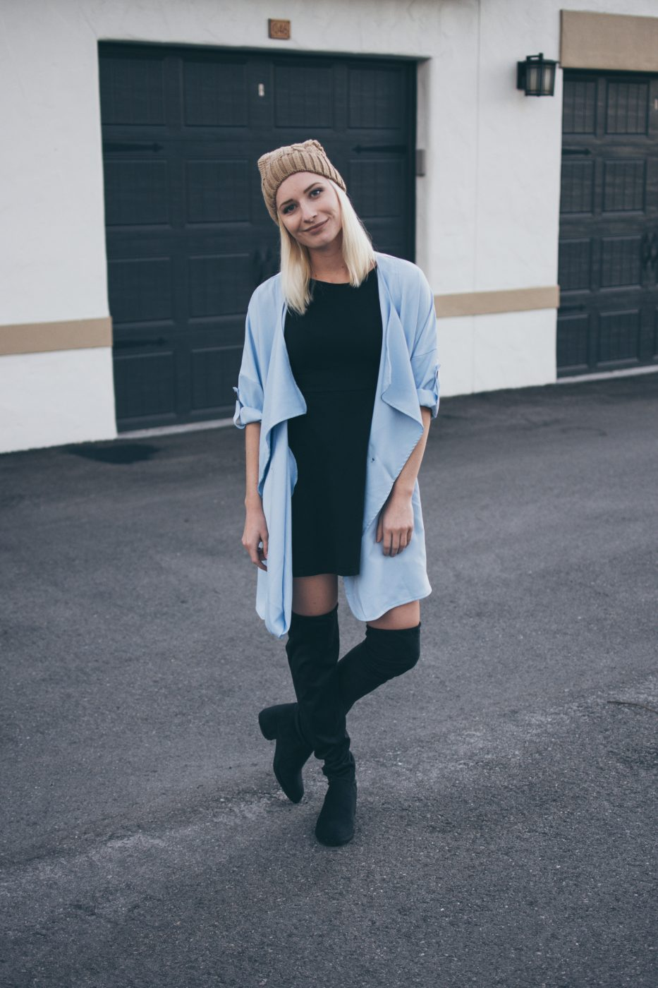 Jenny of Sweet Teal wearing beanie, thigh high boots, black dress, trench
