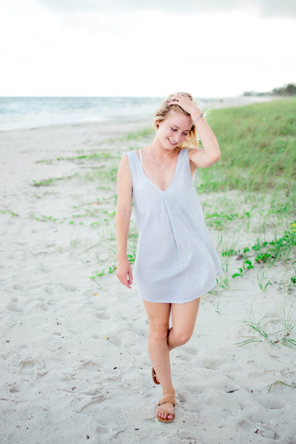 Jenny of Sweet Teal wearing a cotton dress on the beach