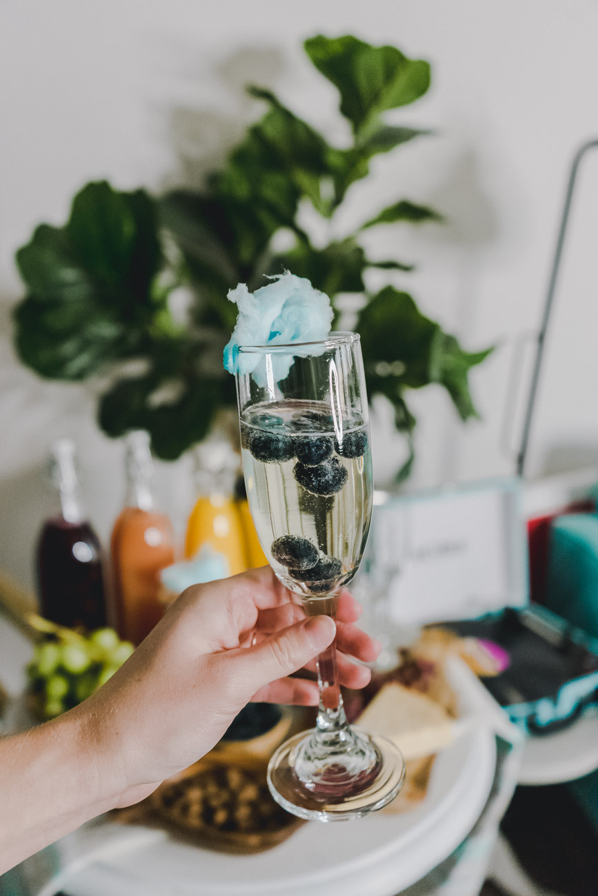 Prosecco with cotton candy and blueberries