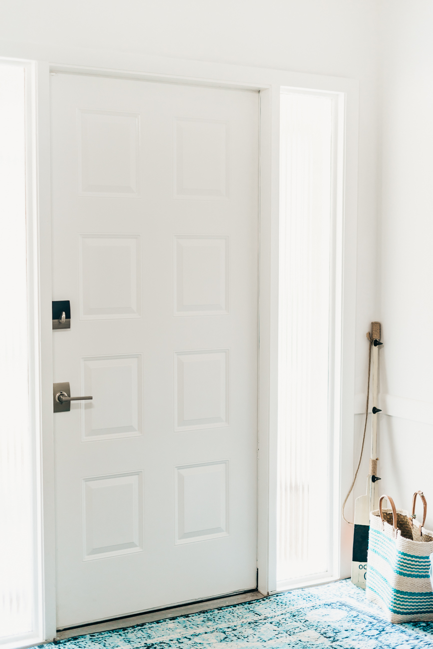 Paint on a steel front door using Chantilly Lace by Benjamin Moore