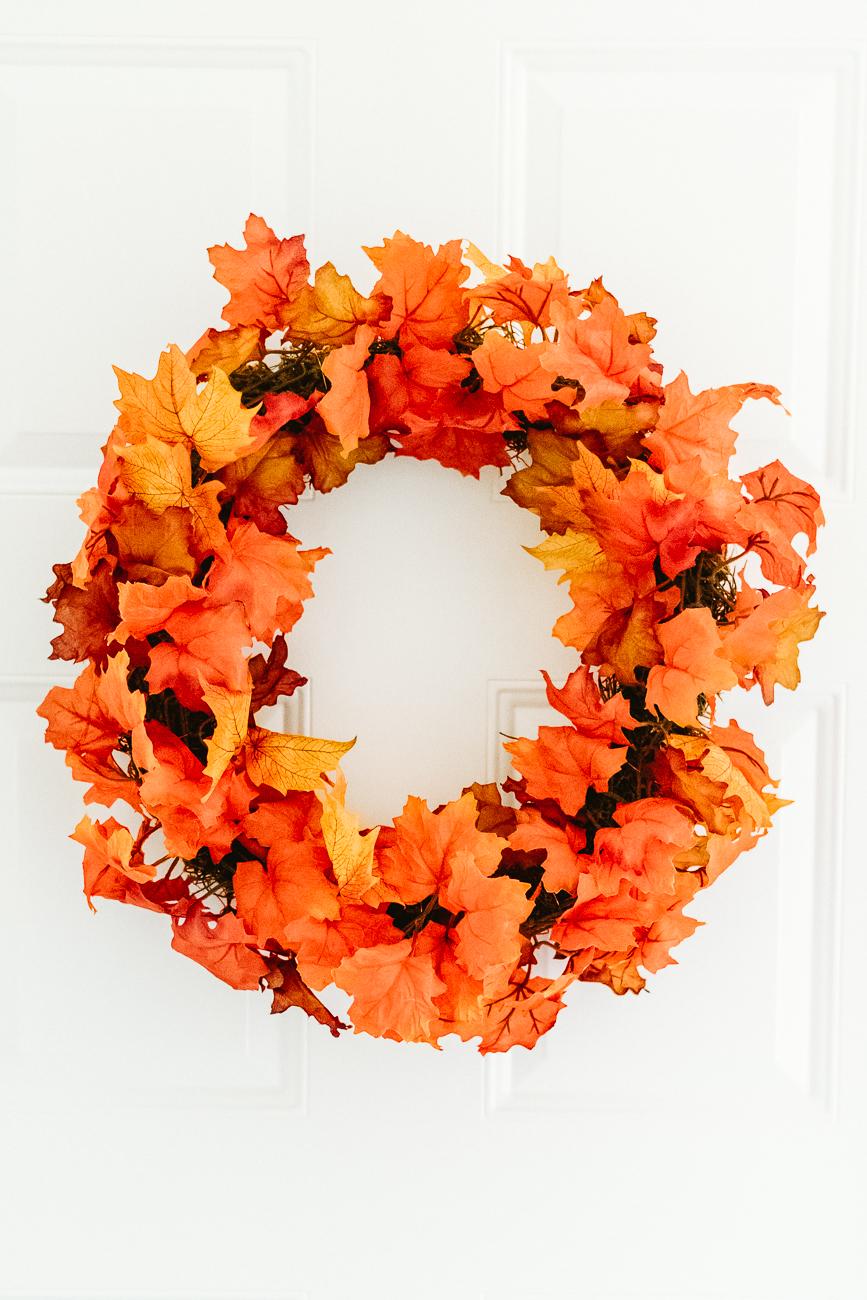 Red and orange fall leaf garland on a wreath