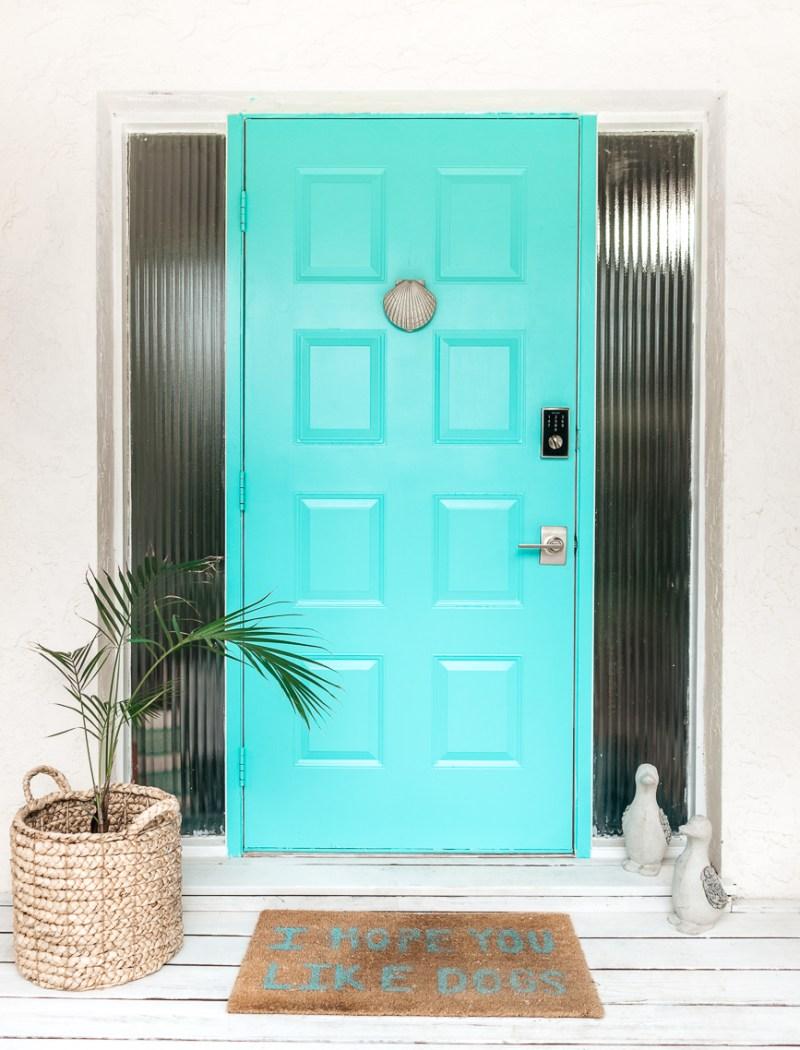 Painted metal door in turquoise
