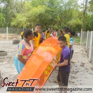 Dragon Boat Racing North Eastern District 6 sweet T&T, Sweet TnT Magazine, Culturama Publishing Company, news in Trinidad, Port of Spain, Trinidad and Tobago, Trini, Caribbean, twin islands, red white black flag, tourism, Joyanne James, Jevan Soyer, travel, vacation, Port of Spain, g, f, how to, photography