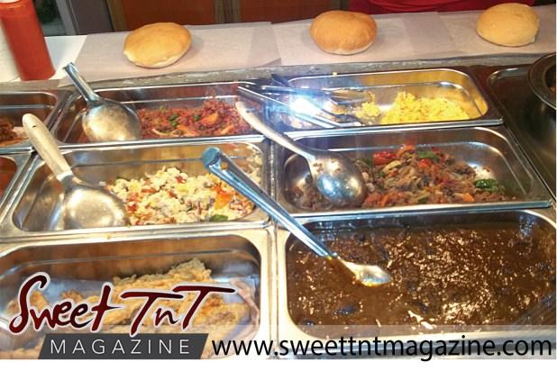 Breakfast serving hops, bake, smoked herring, eggs, prepared by Gail David in Port of Spain