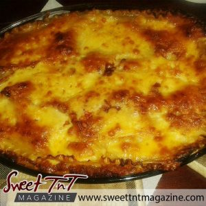 Macaroni pie by Edwin O'Neal - Trinbago woman - in sweet T&T for Sweet TnT Magazine, Culturama Publishing Company, for news in Trinidad, in Port of Spain, Trinidad and Tobago, with positive how to photography.