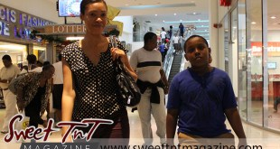 Woman and son walk through Trincity Mall in sweet T&T for Sweet TnT Magazine, Culturama Publishing Company, for news in Trinidad, in Port of Spain, Trinidad and Tobago, with positive how to photography. Equality