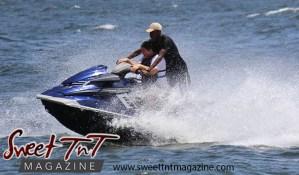 Blue jet ski, man, woman, splash at Chaguaramas Beach in Sweet T&T, Sweet TnT Magazine, Trinidad and Tobago, Trini, vacation, travel Chaguaramas Boardwalk